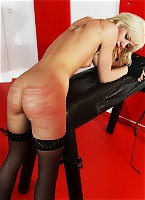 Hot blonde bullwhipping victim