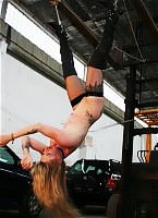 Hanged and lashed under a forklift