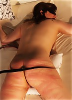 Blindfolded lashed in bedroom